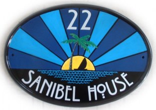 Art Deco style house plaque - the customer asked for an art deco style radiating sun with an island and palmtree and sailing boat painted on a New World classic oval. The font is an art deco period font called Willow. Painted by Gerry