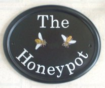 Two Bees - The customer asked for just Two bees on the sign - we tried to persuade the customer to have a pot of Honey as well, but he insisted on just the bees. Painted by Gerry