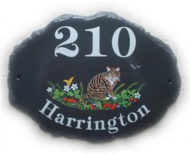 Brown and black tabby cat in a strawberry patch - painted by Jean on a large natural oval