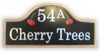 Cherry Trees sign - the customer wanted just a few cherries on each side of the house number. Painted on a large black mews plaque with a gold painted rim