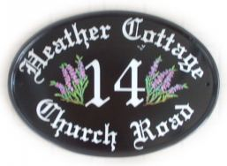 Heather sprigs - the customer asked for Old English Text and a sprig of Heather on either side of the number -painted by Jean on a New World classic oval