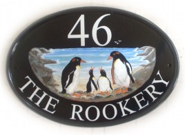 Penguin Family - Painted on a New World Classic Oval by Jean