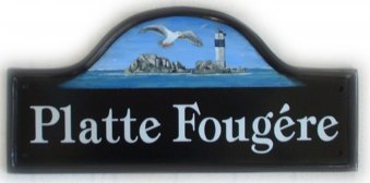 Light house and seagul - This seascape was requested by the customer, it is a pictorial of Platte Fougere Rocks of the coast of Guernsey. Painted on a Large Mews base plaque We found a picture for artwork on Google picture search. Font is called Tiffany. Painted by Gerry