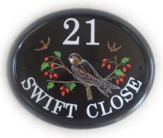 Swift on a Hawthorn branch. The customer sent us a picture of the swift to be painted in the pose shown on the plaque. Painted on a Large classic oval by Jean. Font is called Century Schoolbook.